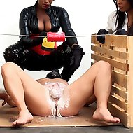 A creative wax device is put into action and served up by two very sexy Mistresses