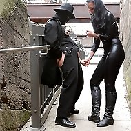 With the slave bound to railings outside, he is subjected to some heavy nipple and CBT play.