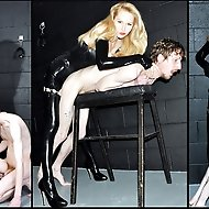 The slave is made to polish his Mistress' rubber stockings and latex-clad bottom. She then sets about making his arse sore inside and out with so