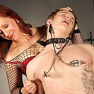 Catherine deSade has her slave in a very difficult position to maintain.  With him gagged, bound, and exposed Catherine puts clover clamps between his