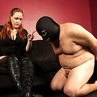 Julie Simone catches her slave breaking her rules.  She wants her slave to admit what he did, so she is going to work it out of him with a classic ove