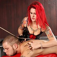 Goddess Soma has Wolf Hudson`s hands and feet bound with rope as he`s bent over a spanking horse.